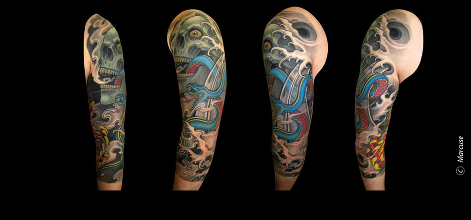 Marcuse | Smilin� Demons Tattoo Studio | tattoo gallery : upper arm tattoo, Colored skull with a blue snake, wave and cloud background