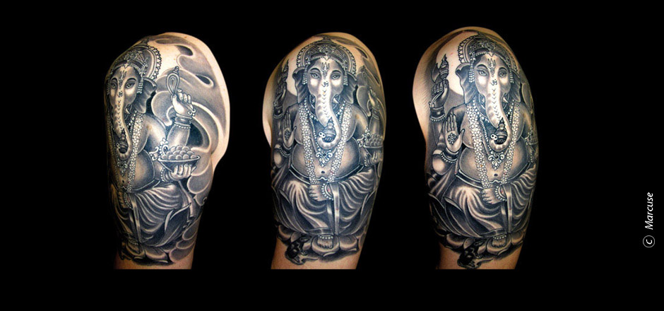 Marcuse | Smilin� Demons Tattoo Studio | tattoo gallery : Ganesha with clouds background in black and gray upper arm