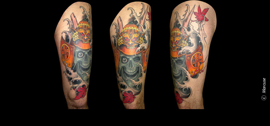 Marcuse | Smilin� Demons Tattoo Studio | tattoo gallery : Colored skull with samurai helmet and maple leaves on the thigh