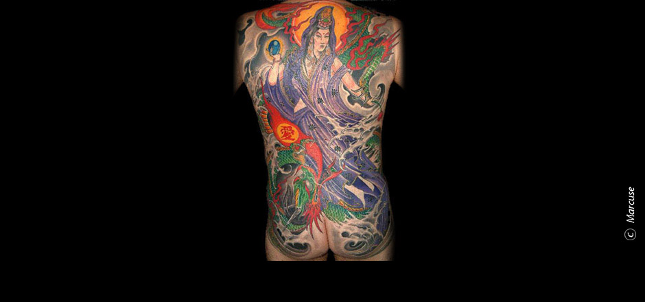 Marcuse | Smilin� Demons Tattoo Studio | tattoo gallery : Buddhist god Kannon on the back with green dragons and Japanese background